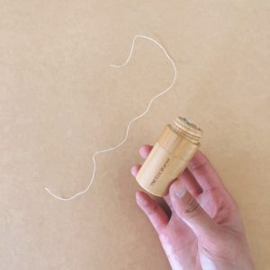 The Eco Warrior Dental Floss in Bamboo Container